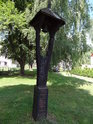 Zvonička na návsi ve Stadicích.